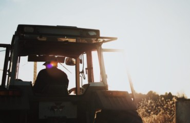 silhouette of tractor on a farm